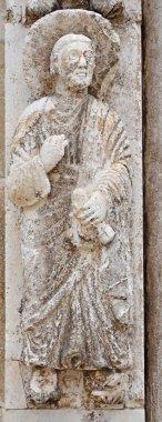 Medieval sculpture of the evangelist