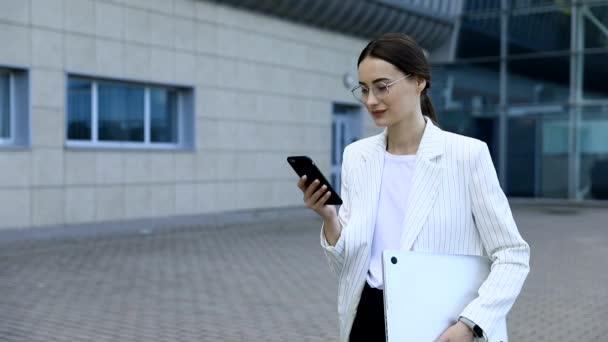 Beautiful young businesswoman wearing white shirt
