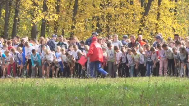 SAMARA, RUSSIA - SEPTEMBER 25, 2016 Children's marathon run in the autumn forest.