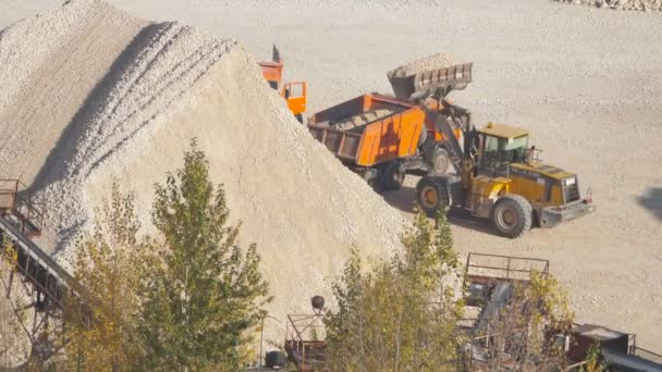 Loading the ore into heavy dump truck at the open cast mining site