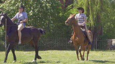 Kaliningrad - May 2017 Russian.  Young boy and girl in cowboy costumes ride horseback and show Corrida. Slow Motion.