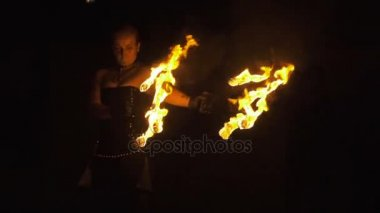 Fiery dance. Amazing magical Fire Show at night. Slow shutter speed. Fire show and a lot of bright sparks in night. Slow Motion. Artist juggling fire in dark. Kaliningrad - July 2017 Russian.
