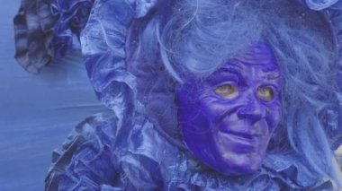 Close-up portrait of a person in a blue mask. Woman with typical beautiful blue mask from traditional carnival. Venice mask portrait. Kaliningrad - July 2017 Russian.