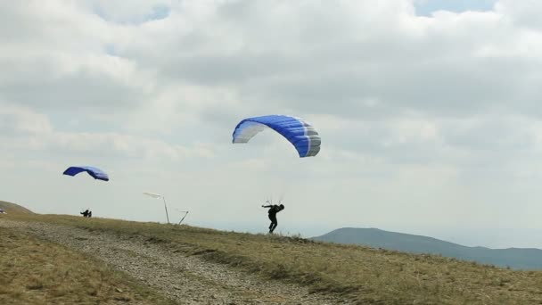 the wind blows paraglider to sky