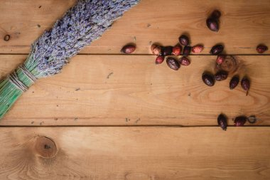 bundle of dried lavender and rosehip berries on a table
