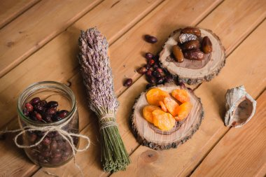 dried fruits on wooden plates and berries