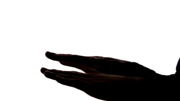 sagoma scura di mani, che ballano