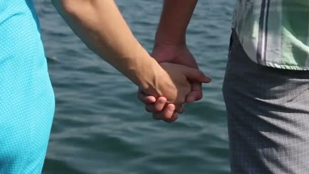 Woman In Blue Dress And Man Let Go Of Hands Against The Sea Stock