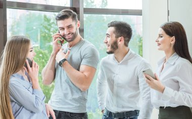 a company of friends, employees make a telephone prank