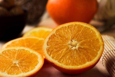 Sliced orange slices. Round orange slices on the table