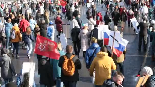 Moscow, Russia - May 9, 2017: Immortal Regiment procession in Victory Day - thousands of people marching toward the Red Square and Kremlin in memory of the participants of the World War Two