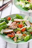 Grilled chicken salad with tomatoes and parmesan cheese