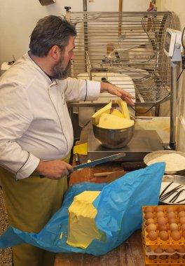 Cook weighting butter