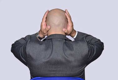 Businessman covering ears