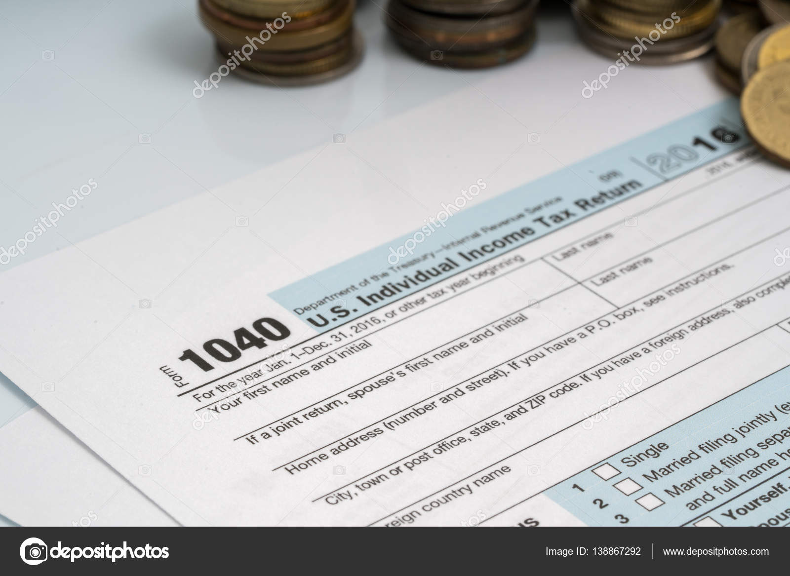 1040 tax return form stock photo akubest79 138867292 1040 tax form with coins and calculator photo by akubest79 falaconquin