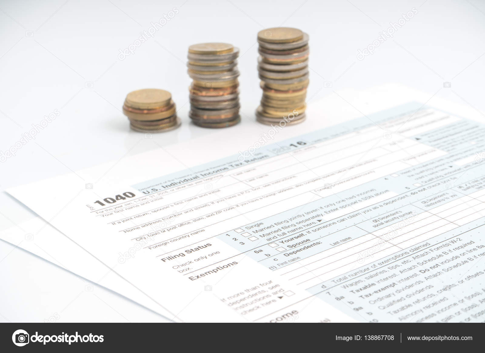 1040 tax return form stock photo akubest79 138867708 1040 tax form with coins and calculator photo by akubest79 falaconquin