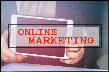 Hand and text ONLINE MARKETING with vintage background. Technology concept.