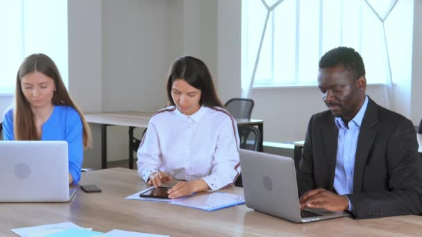 diverse employees sitting at the workplace staff celebrate great deal