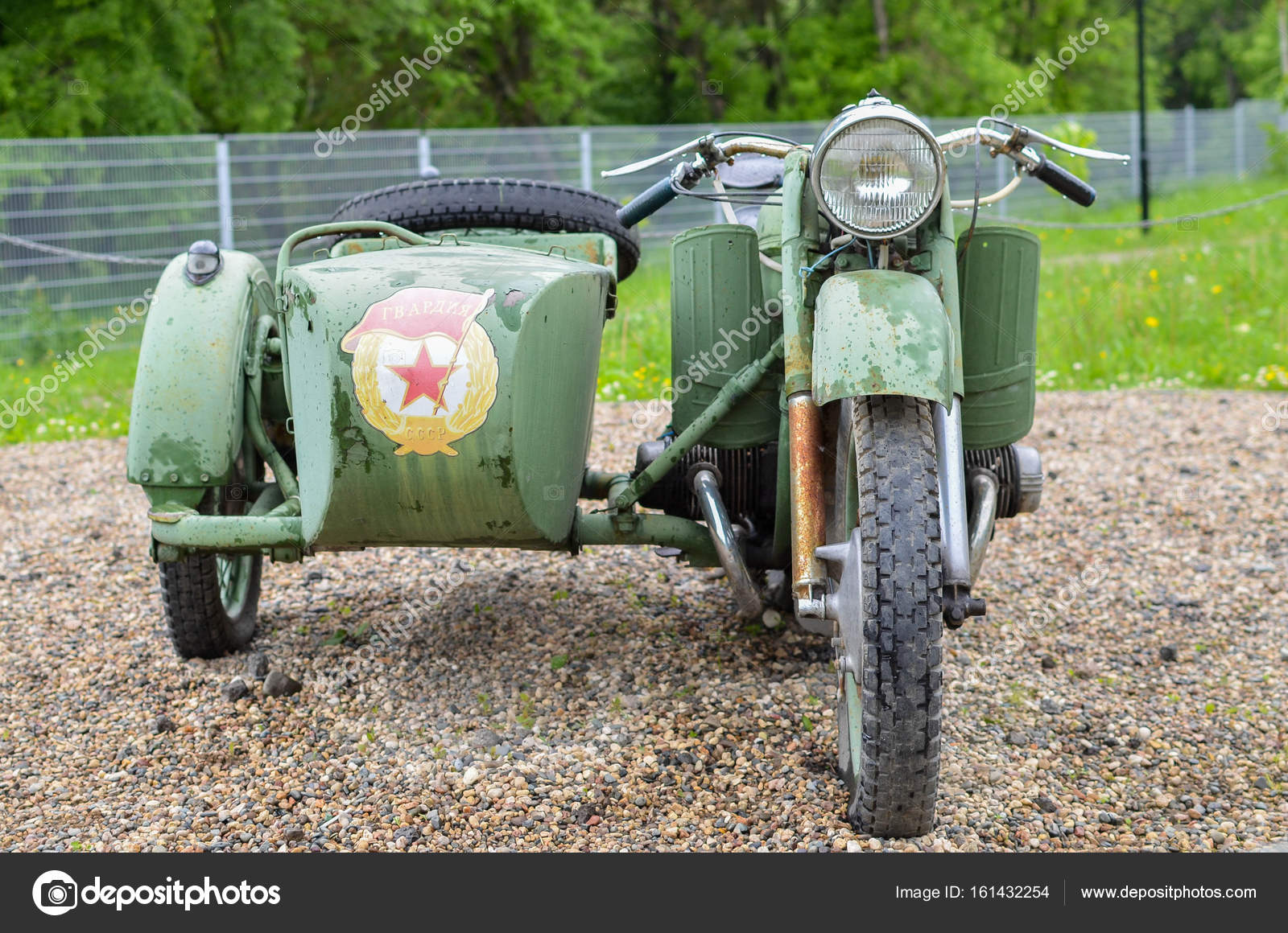 Russian vintage sidecar military motorcircle in rainy day