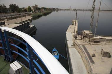 Passage of a tourist cruise through the lock of the Nile River at the height of the city of Esna in Egypt, Africa. Great engineering work that saves an unevenness of 8 meters.
