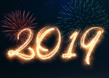 Happy New Year 2019 written with sparkle fireworks displayed on a dark night sky. Shiny bright glowing festive holiday illustration for New Year's and season's greetings.