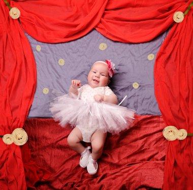 Infant baby girl wearing white ballerina tutu and crocheted ballet slippers