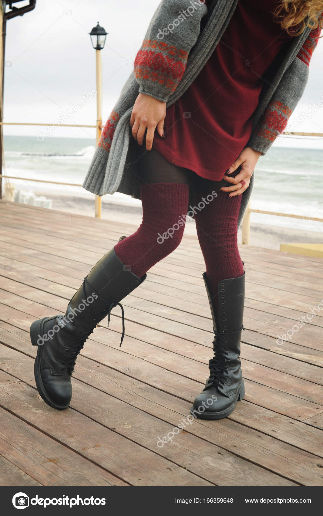 9822132e96d Slim female legs dressed in knee high boots with shoelaces and ...