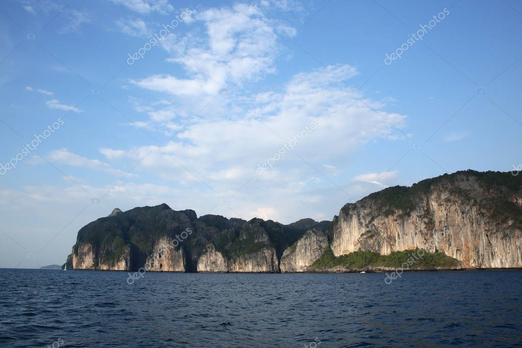 Rugged cliff lined coastline of Koh Phi Phi from the sea, Krabi province, Thailand.