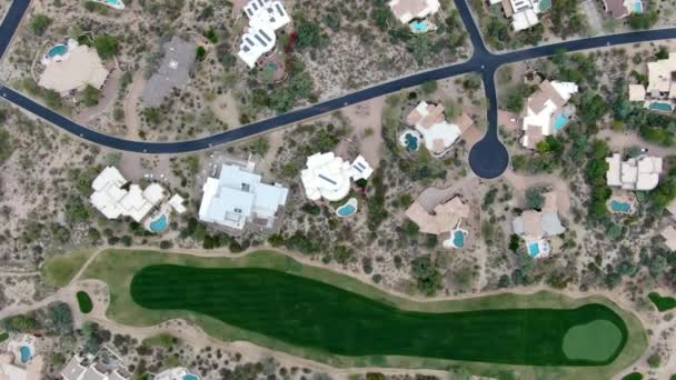Aerial view above golf course and luxury villas, Scottsdale
