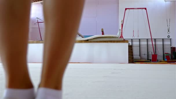 Female gymnast training on the floor of a gym