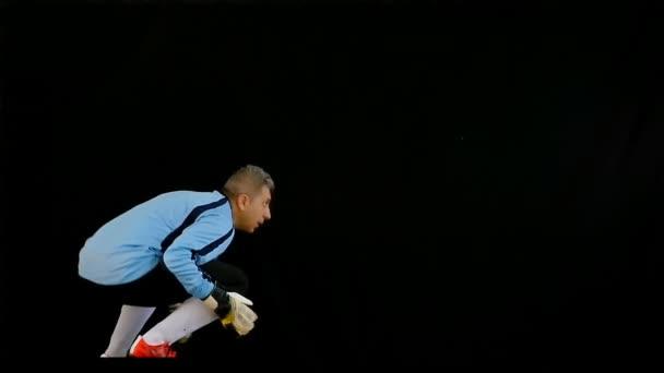 Fotbalový brankář fotbalové skákání na černém pozadí