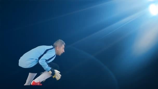 Football soccer goalkeeper jumping on black background