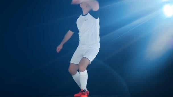 Football game. Soccer action. Goal keeper/footballer kicking a ball, slow motion