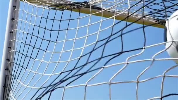 Slow motion of football soccer ball goal into net