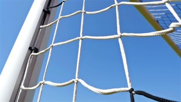 Detail shot of soccer football door net, low angle