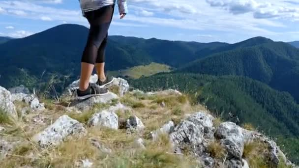Low angle of woman on top of mountain at Sunset Hiker Girl celebrating life scenic nature landscape enjoying vacation travel adventure, 4k