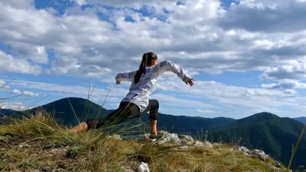 Woman on top of mountain stretching at Sunset view Hiker Girl celebrating life scenic nature landscape enjoying vacation travel adventure, 4k