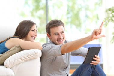 Couple planning decoration at home