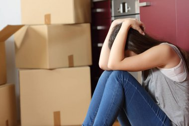 Sad evicted woman worried moving house