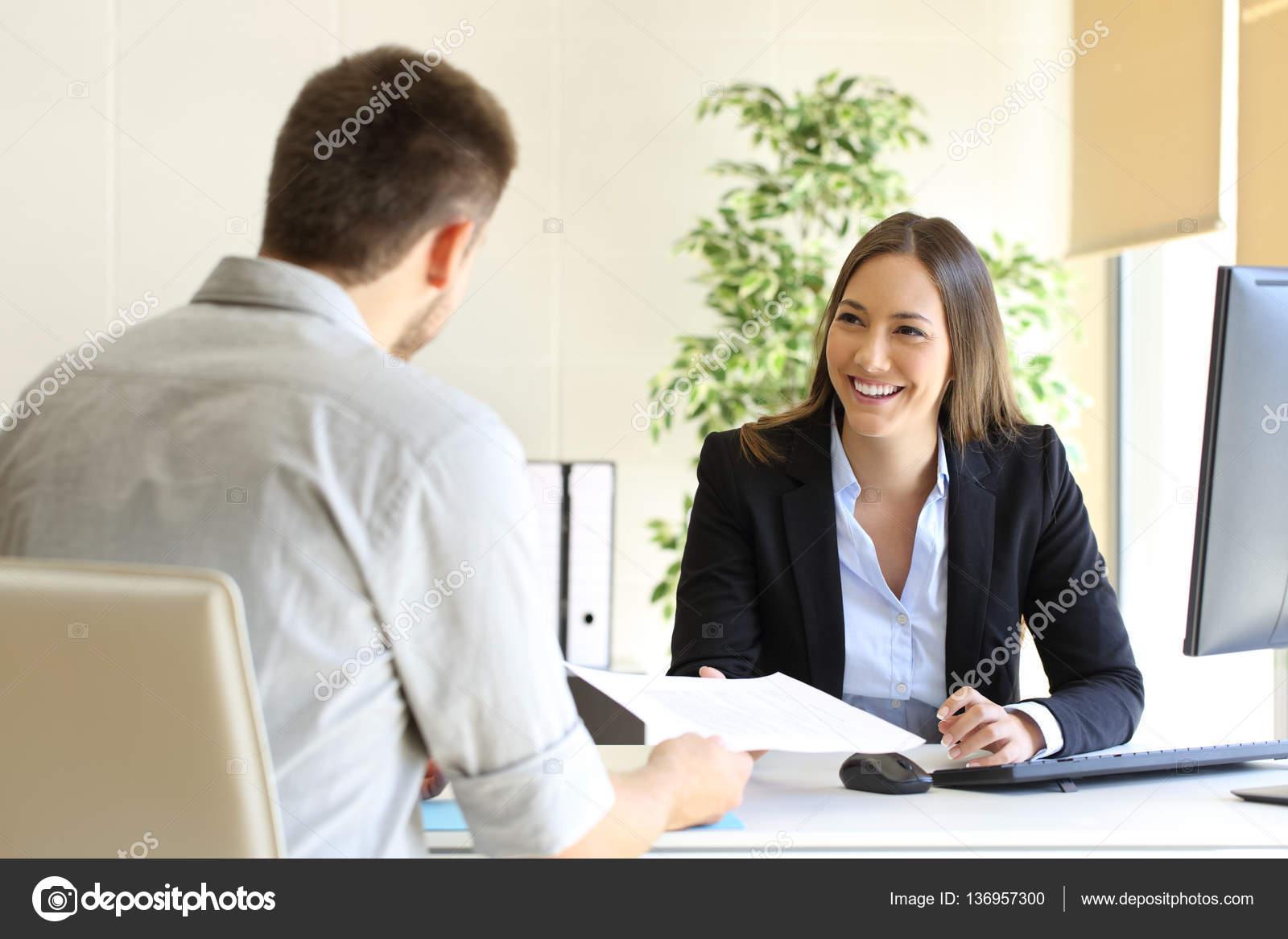 man giving curriculum in a job interview ストック写真