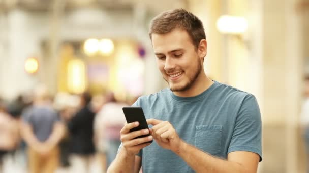 Happy man using a smart phone ⬇ Video by © AntonioGuillemF Stock Footage  #168262322