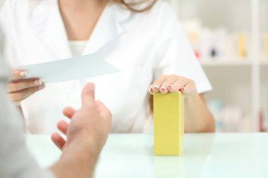 Pharmacist preparing medicine reading recipe