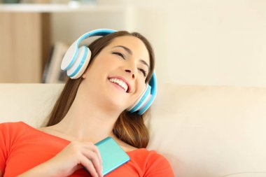 Candid girl wearing headphones listening to music