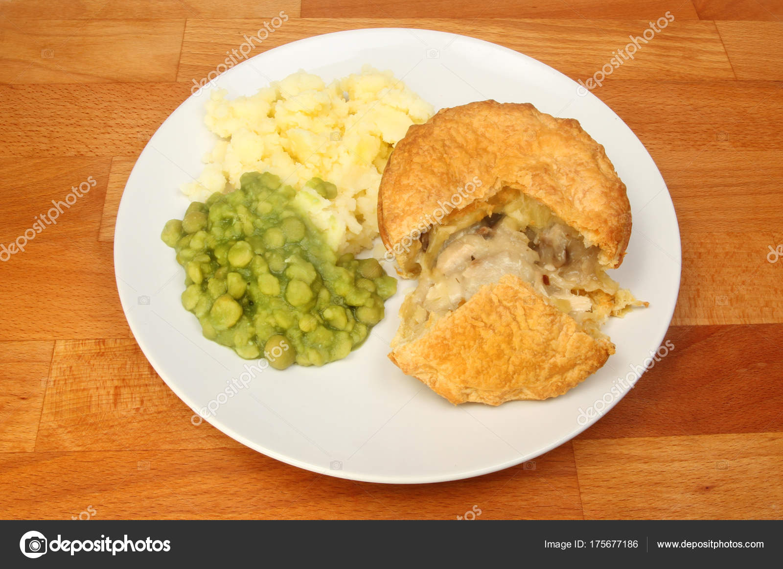 Chicken and mushroom pie with mashed potato and mushy peas on a plate on a wooden tabletop \u2014 Photo by griffin024 & Chicken pie with vegetables \u2014 Stock Photo © griffin024 #175677186