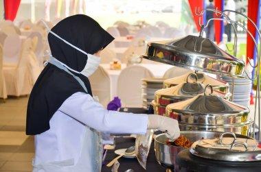 Environmental Health Officer sampling food