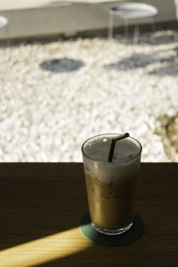Glass of milk coffee drink on wooden table