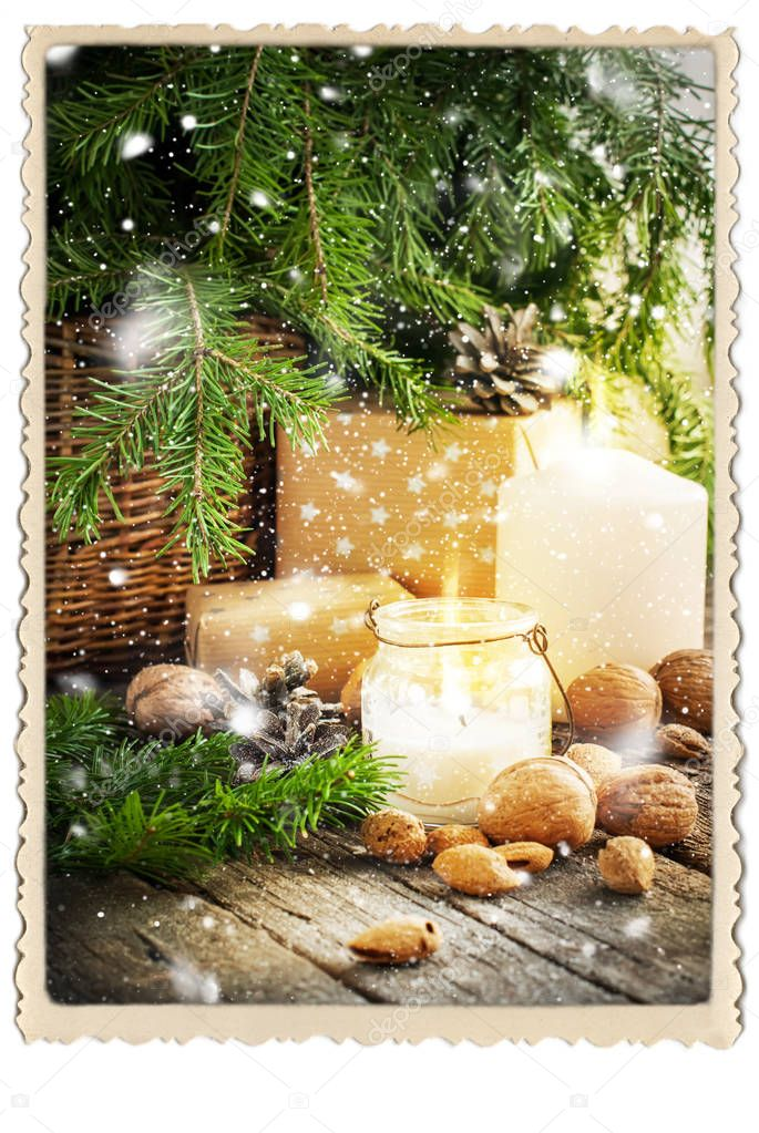 vintage christmas card gifts burning candle falling snow stock photo - Vintage Christmas Gifts