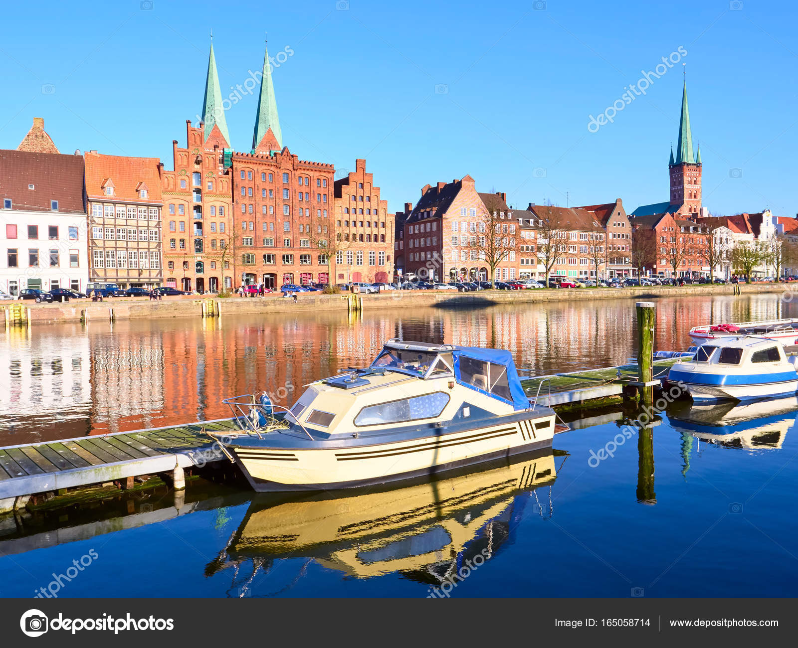 Boats and historic buildings at trave river old town of lubeck boats and historic buildings at trave river old town of lubeck stock photo publicscrutiny Image collections