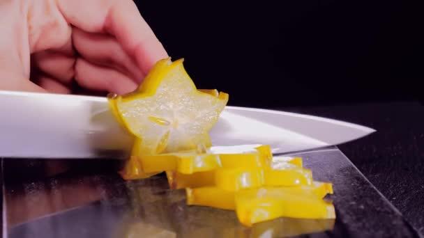 Cutting Exotic starfruit. Averrhoa carambola