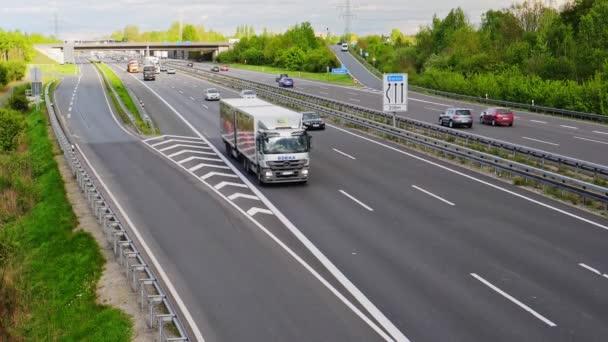 Truck of EDEKA on the freeway, traffic jam on german highway.